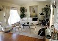 客厅,沙发,茶几,椅子,装饰画,背景墙,窗帘,植物