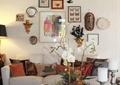 客厅,沙发,茶几,摆件,花瓶插花,背景墙