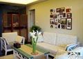 客厅,沙发,茶几,相片,背景墙,隔断屏风,插花摆件