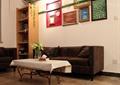 客厅,茶几,沙发,书架,背景墙,装饰画
