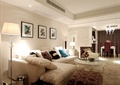 客厅,沙发,茶几,背景墙,地灯,装饰画,摆件,地毯,凳子,垃圾桶