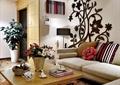 客厅,沙发,茶几,盆栽,墙饰,插花花瓶